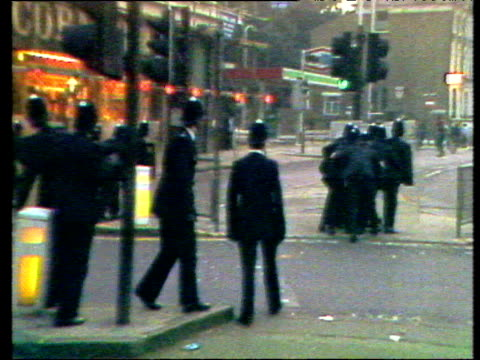 groups of youths hurl bottles and stones at advancing police behind riot shields during second outbreak of rioting - 1981 stock videos & royalty-free footage