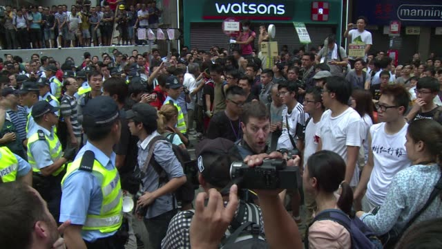 groups opposing hong kongs pro democracy movement hurl abuse at the protesters and use force to try to clear their barricades - occupy central stock videos & royalty-free footage