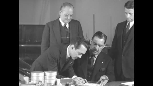 Grover Whalen president of the 1939 New York World's Fair signs checklist of items to be included in the Westinghouse Time Capsule which is to be...