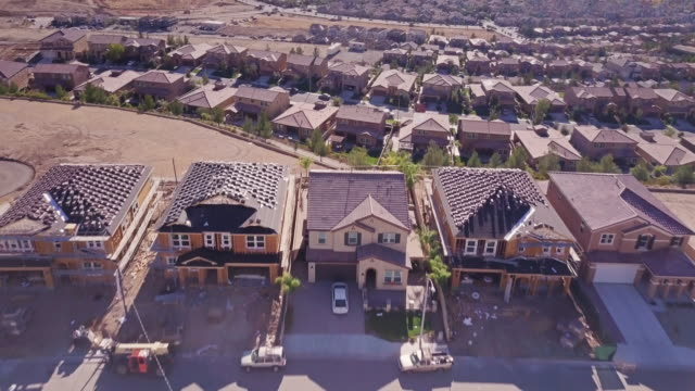 growing american suburb - aerial view - tract housing stock videos & royalty-free footage