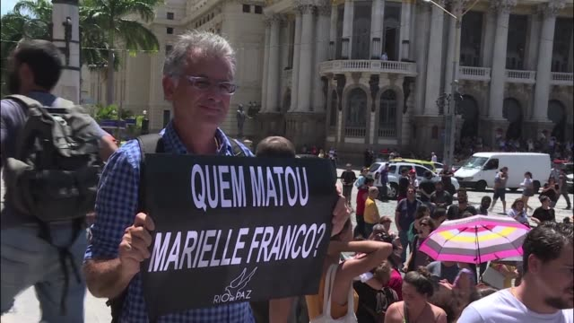 growing crowd gathered in central rio de janeiro on thursday to mourn a leftist city councilwoman and outspoken critic of police brutality who was... - critic stock videos & royalty-free footage