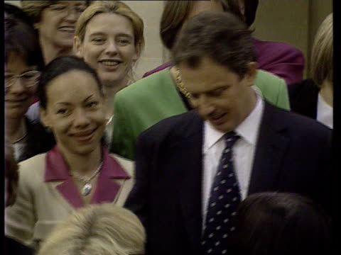 growing fears that women will bear brunt of welfare reforms itn lib london tony blair mp posing with women labour mps after election - parlamentsmitglied stock-videos und b-roll-filmmaterial