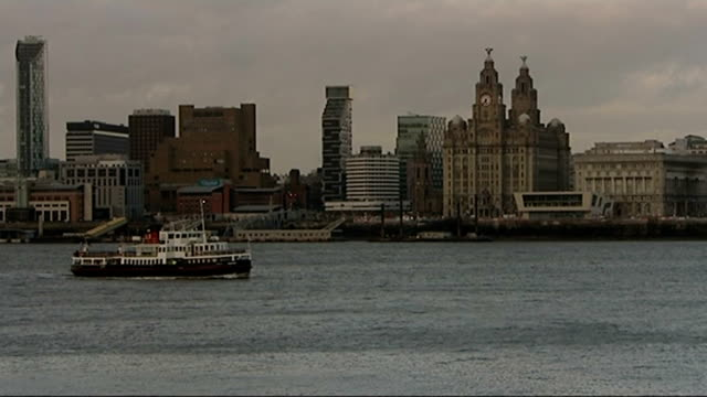growing gap between the rich and the poor; r27030907 / liverpool: ext ferry boat along in river mersey with royal liver building seen in background... - mersey ferry stock videos & royalty-free footage
