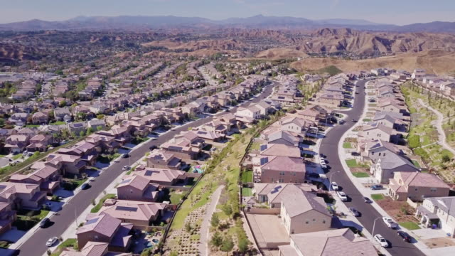 growing suburban development - aerial view - tract housing stock videos & royalty-free footage
