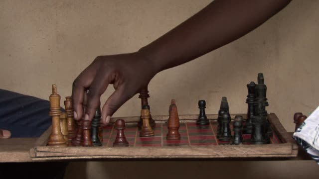 growing up in the slums of uganda phiona mutesi started playing chess because the club was the one place where she could eat a free meal. clean :... - kampala stock videos & royalty-free footage