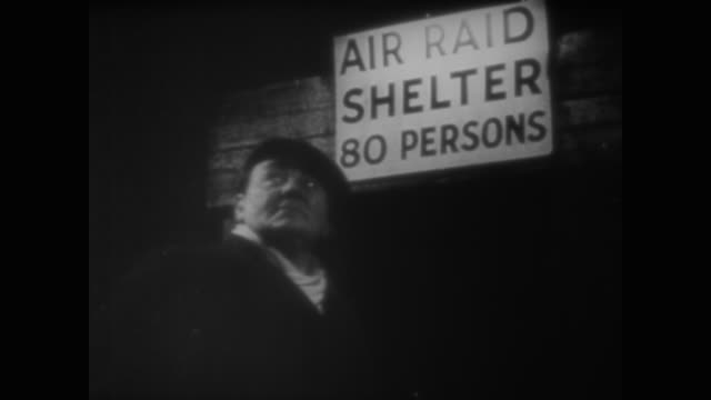 vídeos y material grabado en eventos de stock de growing used to tin hats and ration books, the people of london settle into an air raid shelter for the night - air raid