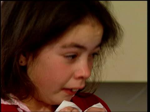 vídeos y material grabado en eventos de stock de growth in allergy sufferers lib girl sneezing - estornudar