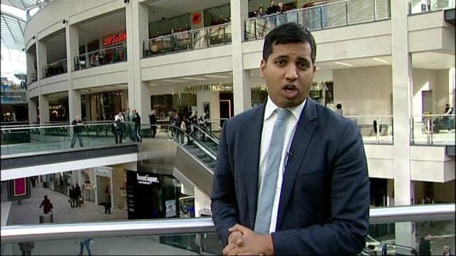 growth increases to 0.8 per cent; leeds: int reporter to camera in shopping centre vox pops shoppers sot shoppers travelling up and down on... - sun roof stock videos & royalty-free footage