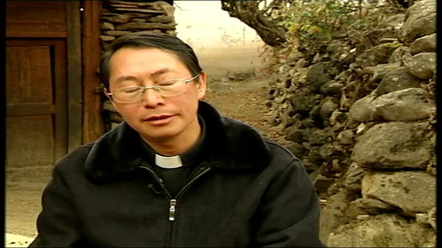 growth of christianity ext father tao zhubin interview sot no government or regime would allow another force to be stronger than itself/ the biggest... - place of worship stock videos & royalty-free footage