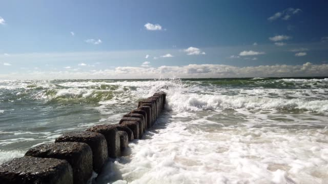 groynes on the beach of sylt. blue sky. - tina terras michael walter stock videos & royalty-free footage