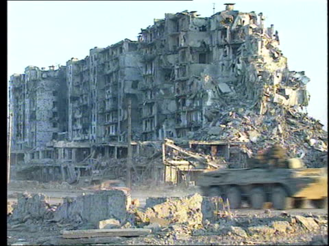 grozny gvs wreckage of buildings destroyed by russian shelling - grosny stock-videos und b-roll-filmmaterial