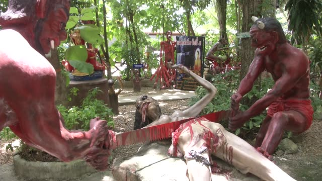 Gruesome statues of scenes from hell at Wat Mae Kaet Noi or the Hell Temple in Mae rim Chiang Mai Thailand It was created by Pra Kru Vishanjalikon or...