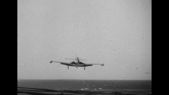 Grumman F9F Panther Jet takes off from Wasp aircraft carrier / Grumman F9F lands on Wasp / MS crew on deck direct plane / CU another Grumman F9F land...