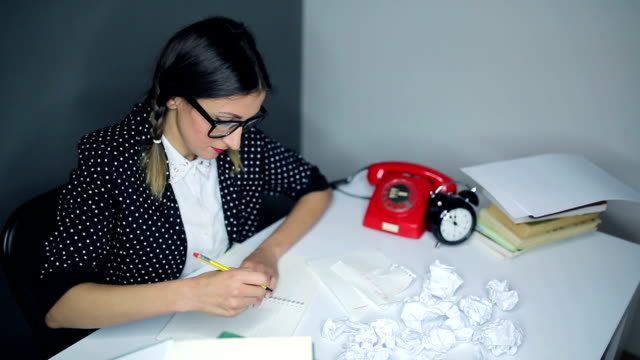 grumpy nerdy woman in her retro office - crumpled paper stock videos and b-roll footage