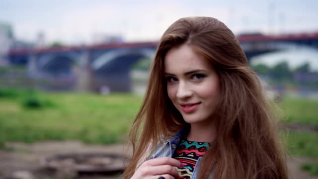 Grunge brunette girl in big city.