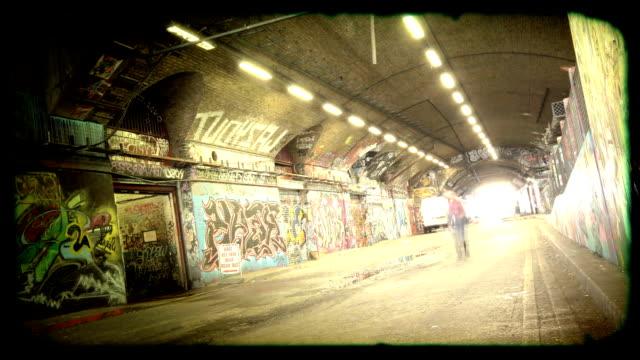 grunge graffiti tunnel time-lapse loop. hd - graffiti stock videos and b-roll footage