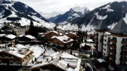 Gstaad snowfall approach - Aerial 4K