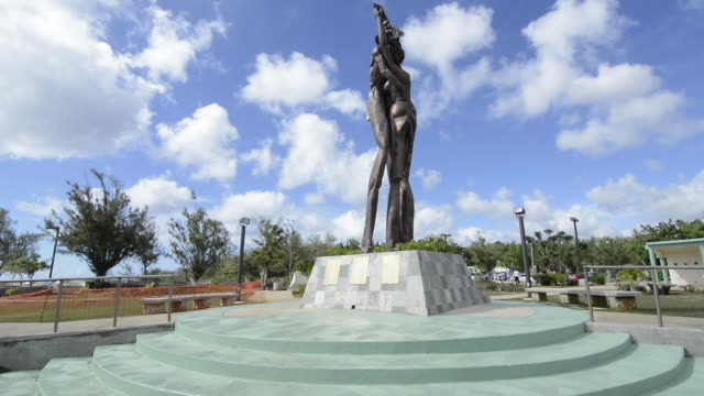 guam usa territory famous two lovers point for tourists attraction statue of two lovers - guam stock videos and b-roll footage