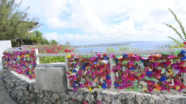guam usa territory famous two lovers point for tourists attraction lovers heart locks on fence - guam stock videos and b-roll footage
