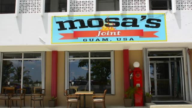 guam usa territory local bar called mosa's joint for fun - bar点の映像素材/bロール