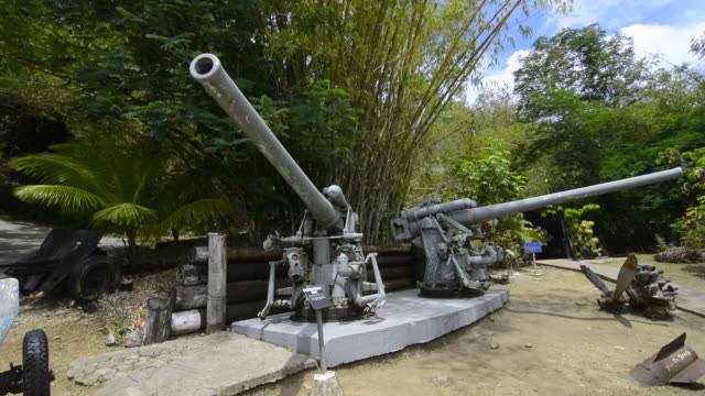 guam usa territory pacific war museum with japanese 120 mm guns for tourists and war machinery - guam stock videos and b-roll footage
