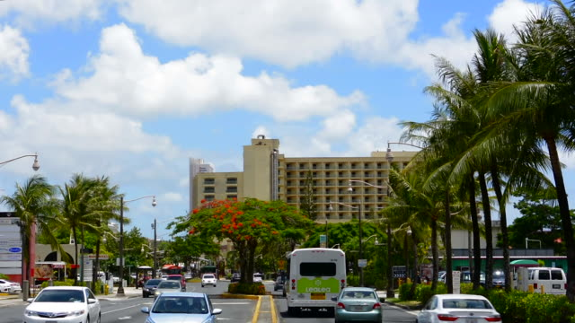 guam usa territory traffic on main street in tumon bay in tourist district of country - guam stock videos and b-roll footage