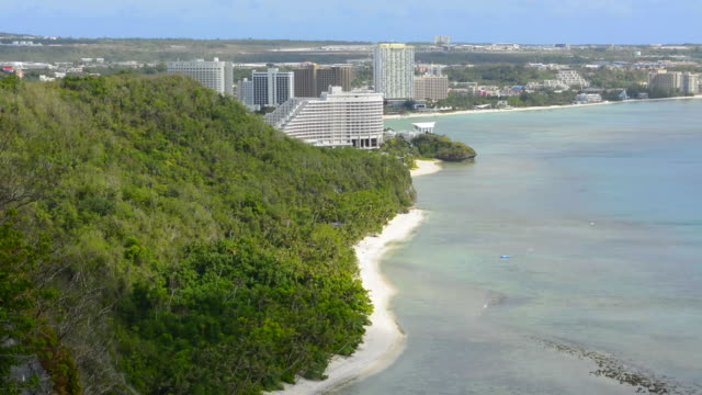 guam usa territory tumon bay hotels and beach from above with ocean beach from two lovers point - guam stock videos and b-roll footage