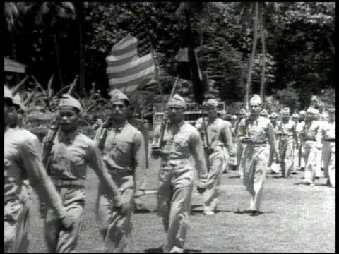 guam's volunteer militia marching in parade formation on base chamorro children attending school w/ teacher writing at desks watching raising of... - pacific islander teacher stock videos & royalty-free footage