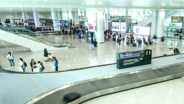 t/l ws td guangzhou airport luggage hall - baggage claim stock videos and b-roll footage