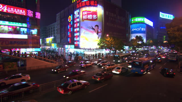 guangzhou business district at night - bus billboard stock videos & royalty-free footage
