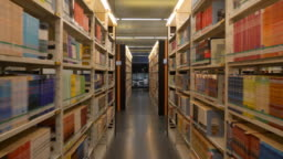 guangzhou city library reading hall shelfs slow motion walking view