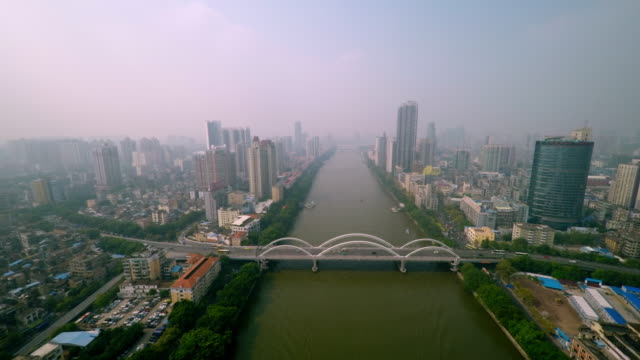 guangzhou skyline - drone flight over pearl river at daytime - spoonfilm stock-videos und b-roll-filmmaterial