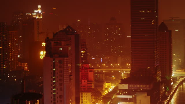 guangzhou skyscrapers at night – narrow shot - spoonfilm stock-videos und b-roll-filmmaterial