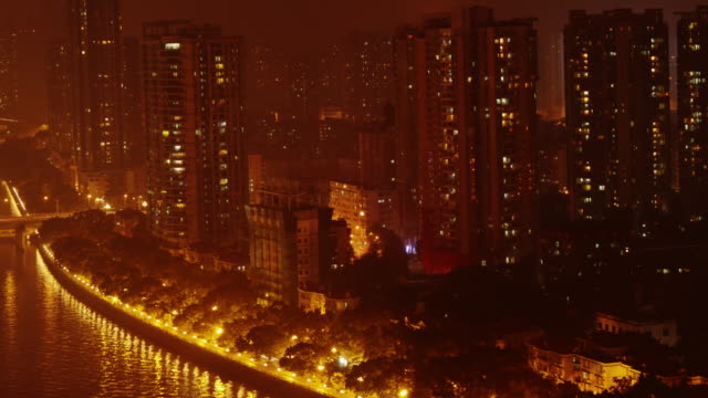guangzhou skyscrapers on pearl river at night - spoonfilm stock-videos und b-roll-filmmaterial