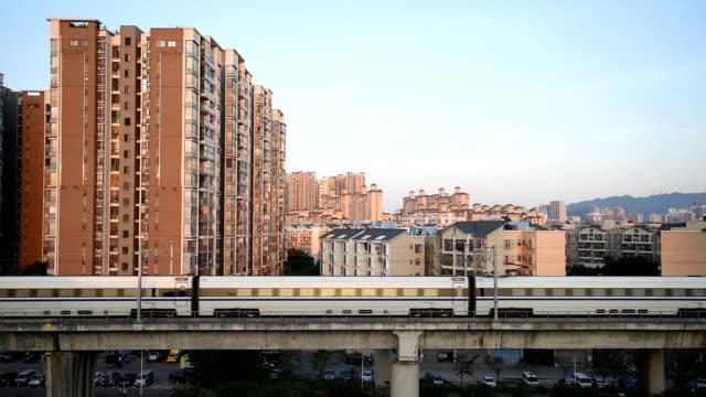 vídeos de stock e filmes b-roll de guangzhou zhuhai intercity trains in zhuhai, china - comboio elevado