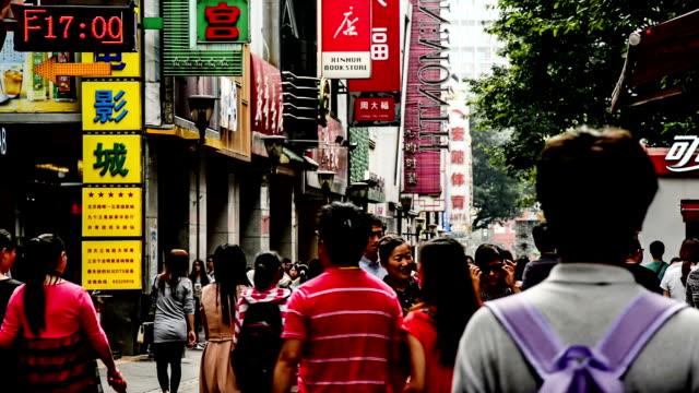 guangzhou,china-nov 29,2014: people roam the famous shopping street-beijing road in guangzhou, china - guangzhou stock videos & royalty-free footage