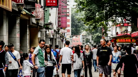 guangzhou,china-nov 29,2014: people roam the famous shopping street-beijing road in guangzhou, china - midsection stock videos & royalty-free footage