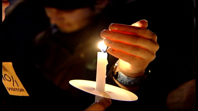 british prisoner in legal black hole ext / night downing street close up of campaigners holding candles during vigil to mark 5th anniversary of the... - amnesty international stock videos & royalty-free footage