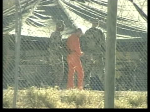 guantanamo bay britons will not face death penalty lib guantanamo bay detainee led along at camp xray - camp x ray stock videos & royalty-free footage