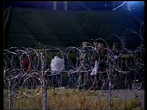guantanamo bay - detainee treatment; pool via aptn night lmss detainees wearing towels & face masks led along by soldiers lms us troops standing... - guantanamo bay stock videos & royalty-free footage