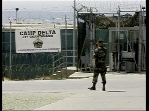 five british men released lib cuba guantanamo bay camp delta us soldier by camp delta entrance gate us coast guard boat along - camp x ray stock videos & royalty-free footage