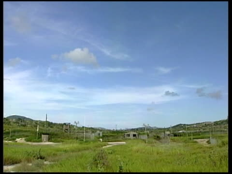 general views camp xray various general views of disused camp xray including barbed wire fencing watchtowers disused buildings of older camp blocks... - camp x ray stock videos & royalty-free footage