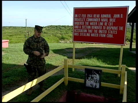 General views CUBA Guantanamo Bay Naval Base EXT US soldier showing historical site on hill at Guantanamo military base where hole was dug in 1964 to...