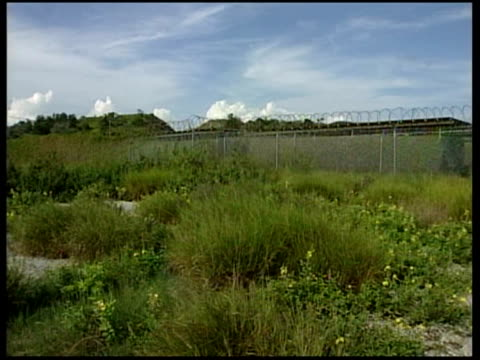 general views more general views of disused camp xray at guantanamo bay prison including watchtower silhouetted against sky overgrown abandoned... - camp x ray stock videos & royalty-free footage