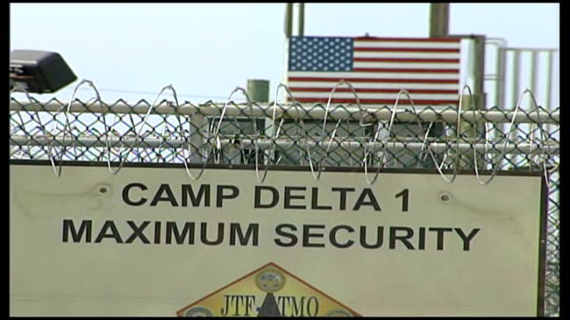 lord falconer to launch fresh attack cuba guantanamo bay naval base camp delta ext american flag hanging from flag post low angle shot of american... - guantanamo bay stock videos & royalty-free footage
