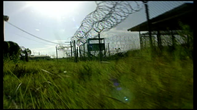 lord falconer to launch fresh attack; wire fence rusty chain low angle shot of wire fence seen from grass track forward int prison guard, from... - door chain stock videos & royalty-free footage