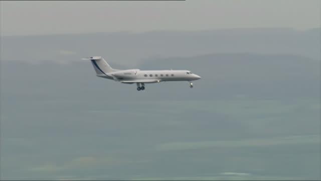 guantanamo detainee shaker aamer returns to uk england london biggin hill airport plane in flight - detainee stock videos & royalty-free footage