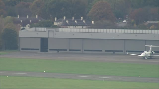guantanamo detainee shaker aamer returns to uk kent london biggin hill airport view / aerial doors of airport hangar being closed after private jet... - shaker aamer stock videos & royalty-free footage