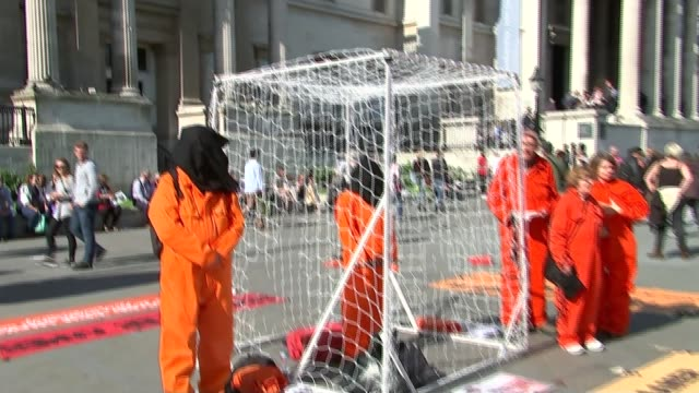 guantanamo detainee shaker aamer returns to uk r16051510 / ext large inflatable figure with the face of shaker aamer pull out supporters dressed in... - jumpsuit stock videos and b-roll footage