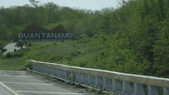 guantanamo signage on road, cuba - guantanamo bay stock videos & royalty-free footage